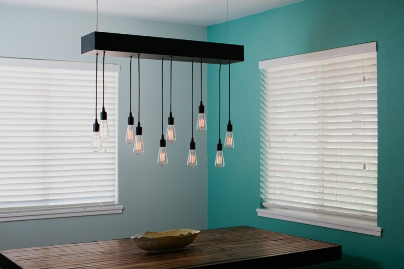 contemporary dining room idea blue walls white window shutters a cluster of industrial bulb pendant light fixtures dark toned hardwood dining table