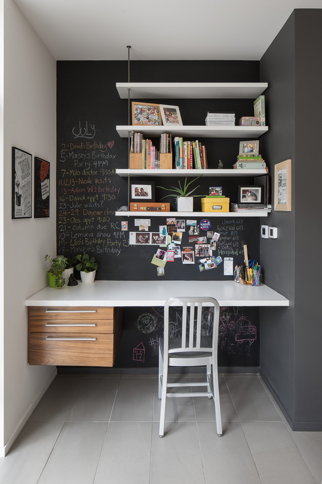 contemporary home office black doff walls ceiling mounted wall shelves in white floating working desk with white top and flat panel drawer system white working chair