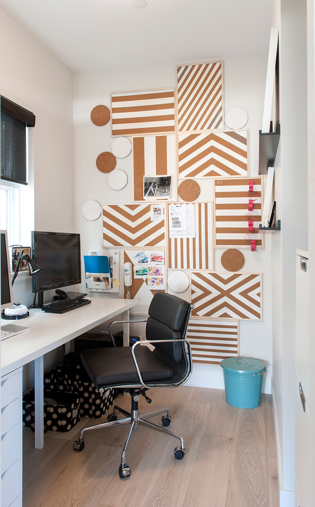 contemporary office room idea wrap paper wall organizer white working table black leather working chair with wheels light toned wood floors
