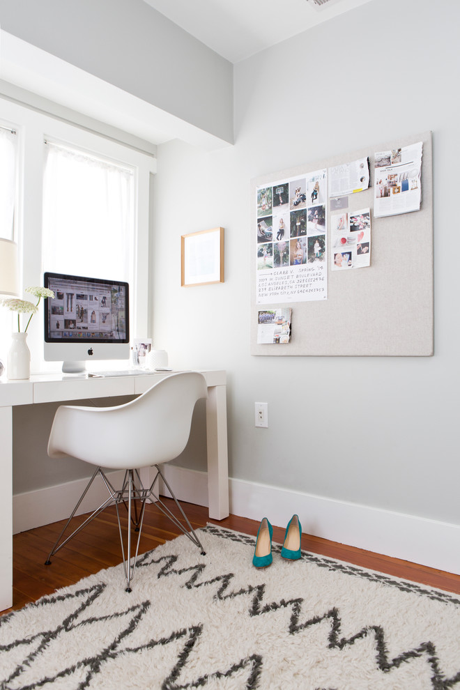 dominant white home office idea white armchair with chrome legs white freestanding working table white wall board organizer white shag rug with modern patterns medium toned wood floors