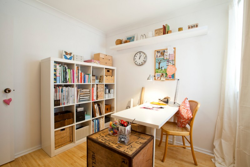 eclectic working space white painting walls medium toned wood floors white working table wood working chair huge white rack white floating shelf
