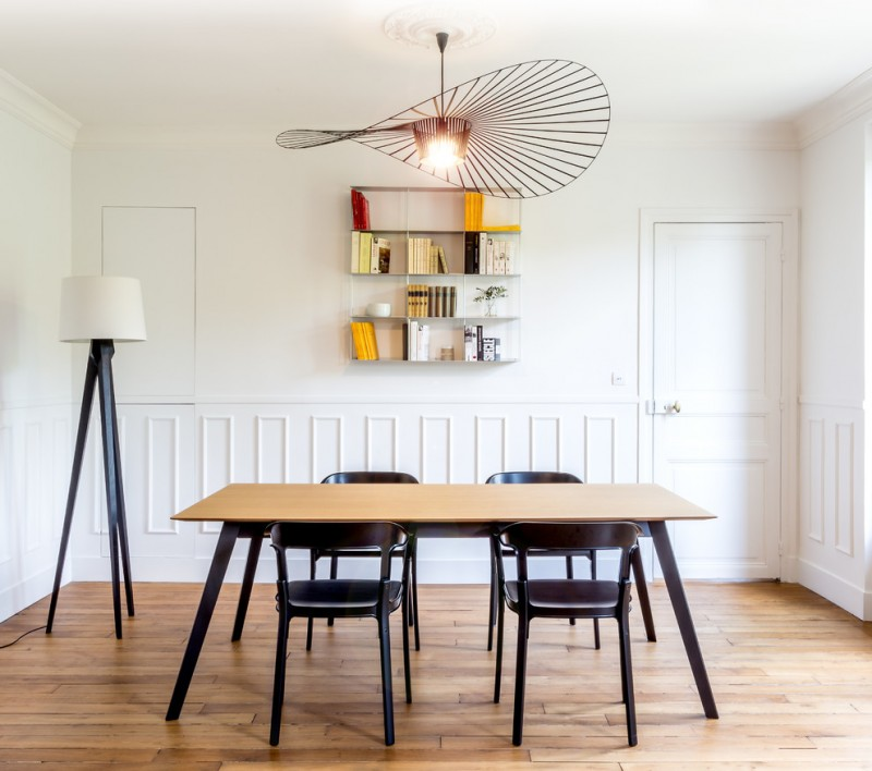 scandinavian style dining room wood top dining table modern black dining chairs simple central book shelf pendant lamp with creative accessory tripod LED floor lamp with white shade