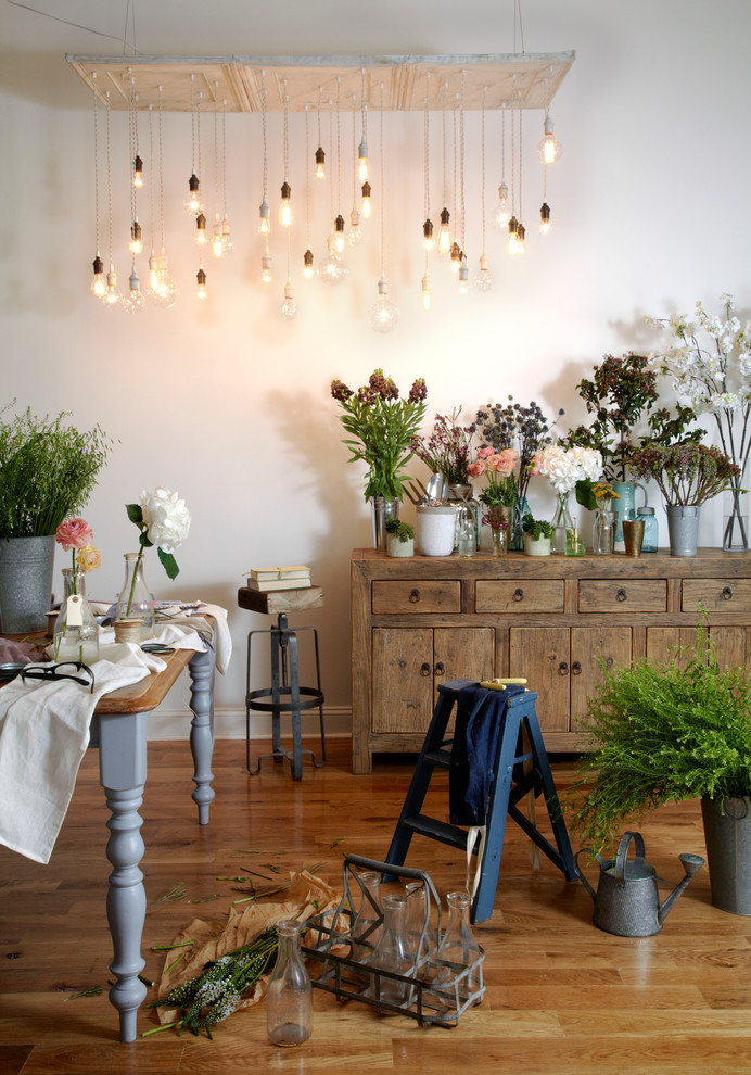 shabby chic loft area shabby wood hall console with potted flowers a cluster of bulb pendant lamps hung on wood ceiling tin medium toned wood floors