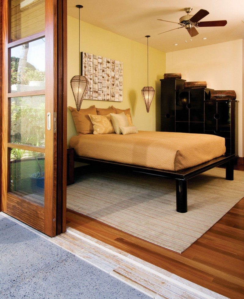 tropical bedroom idea a pair of tuscan hanging light fixtures medium toned wood floors light brown bedding treatment yellow wall system cream walls and ceilings