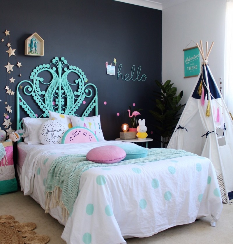 fancy kids' bedroom idea bed frame with hand crafted headboard in blue white bedding treatment with cute blue and pink accents dark wall background