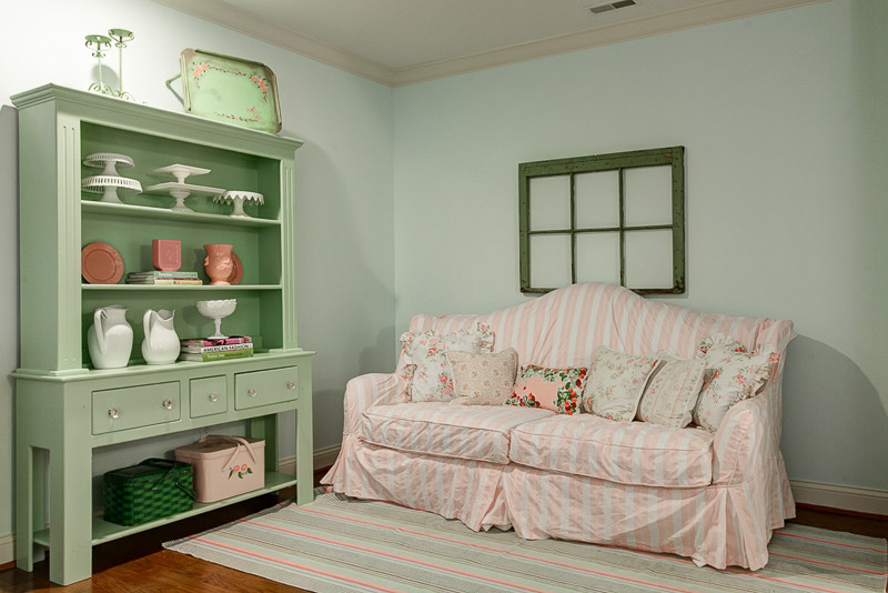 shabby chic family room idea stripped sofa slipcover with accent pillows light green painted display buffet light blue walls stripped area rug medium toned wood floors