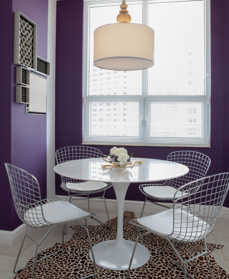 wire backs chairs round top table in white animal patterned area rug deep purple walls