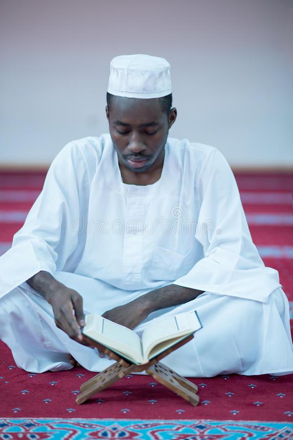 african-muslim-man-praying-to-god-wearing-traditional-cap-dishdasha