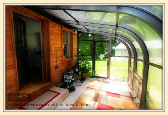 The amazing sunroom of this New Milford CT home for sale allows you to enjoy the view of nature all throughout the year.