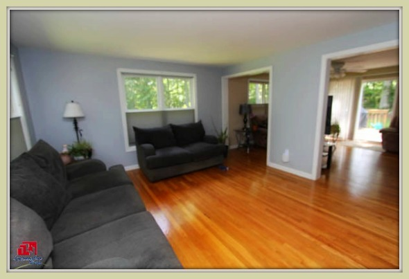 The spacious bonus room next to the living room of this Bethel CT home for sale can function as a family room or extra bedroom.
