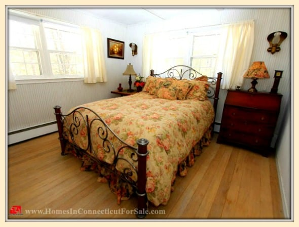 A comfortable master bedroom is just one of the many lovely features of this Sherman CT home for sale.