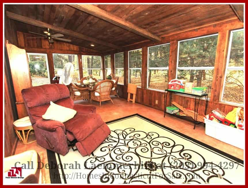 One of the special features of this remarkable New Milford CT equestrian property for sale is the great room nestled on a screened porch offering a magnificent view of the pool and lush greens surrounding the home.