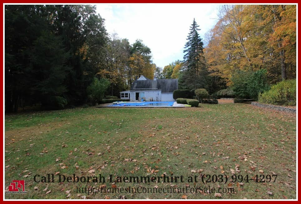 The L-shaped pool in this pristine New Milford CT home for sale is an added attraction to this already irresistible home!