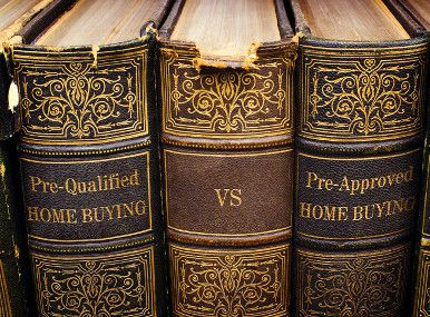 Books showing differences between pre-approved and pre-qualified.