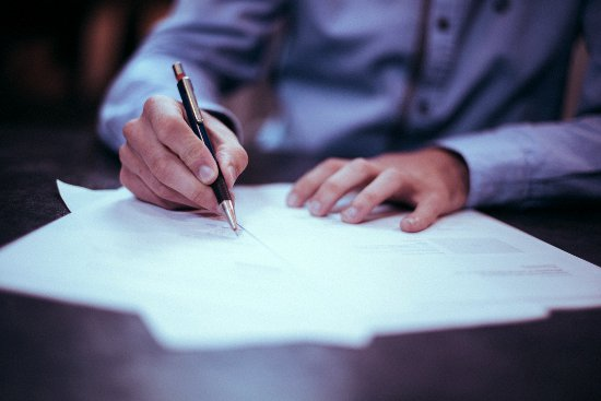 Signing documents at a home closing