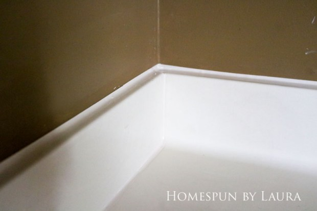 Replacing old caulk makes a dramatic impact in a bathroom. | Homespun by Laura