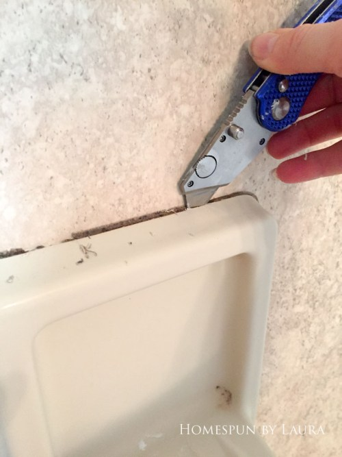 How to replace old caulk for a dramatic impact in a bathroom. | Homespun by Laura