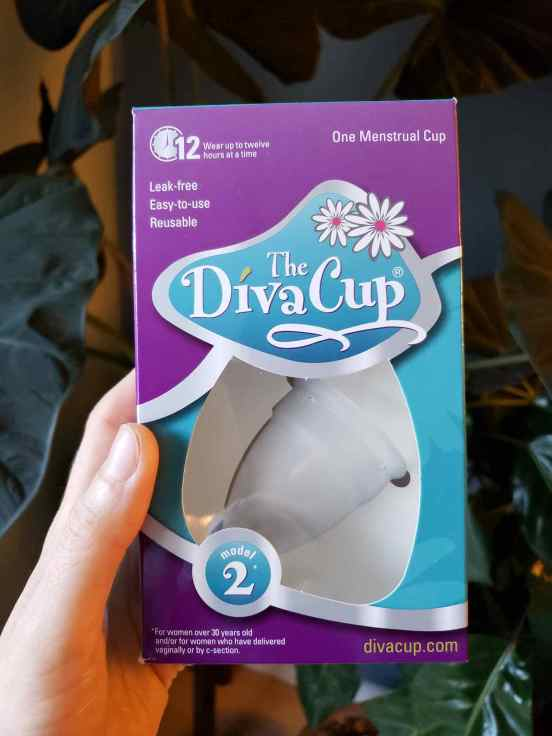 DeannaCat is holding a box of The Diva Cup model 2. Diva Cup was one of the original menstrual cups made available to women worldwide.