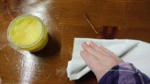 Beeswax furniture polish on a wood dresser