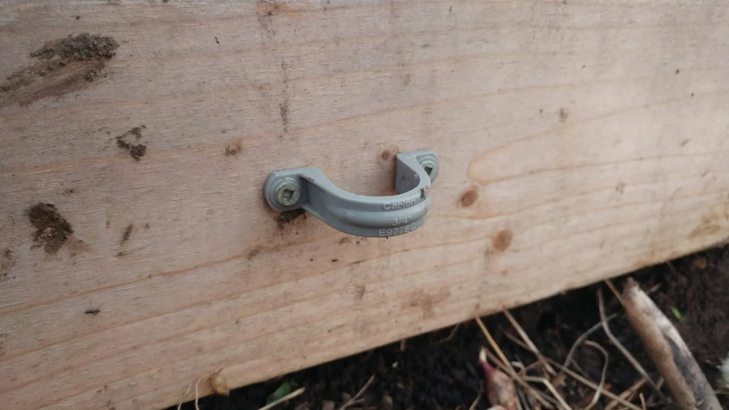 strap clamps on raised bed