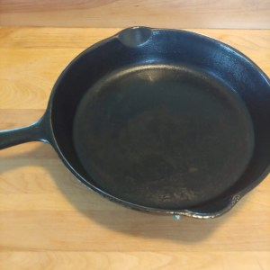 seasoned cast iron pan after one treatment