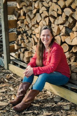 Carrie Williams Howe photo in front of woodshed