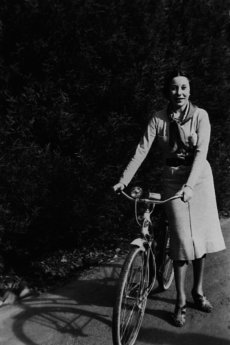 Agnes Temple with a bicycle, 1930s.