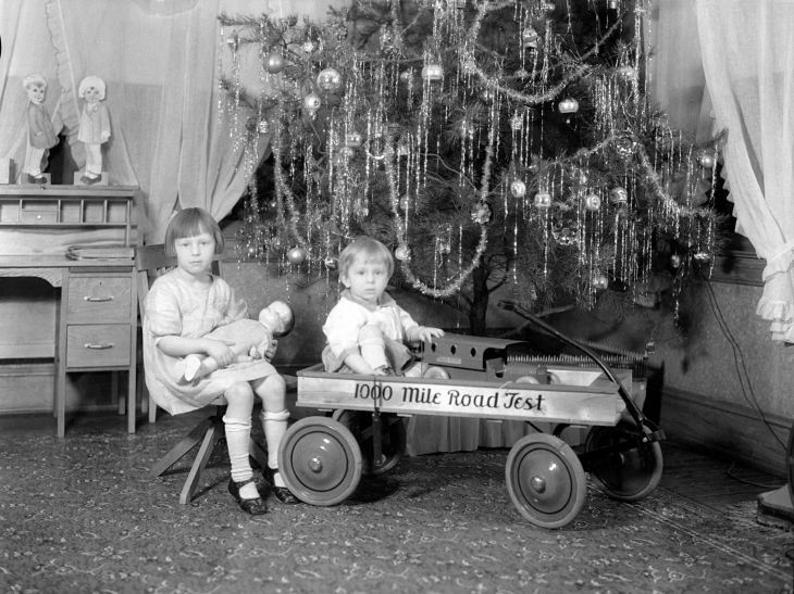 Negative Two Children And Toys Near A Christmas Tree 2012.528.1.