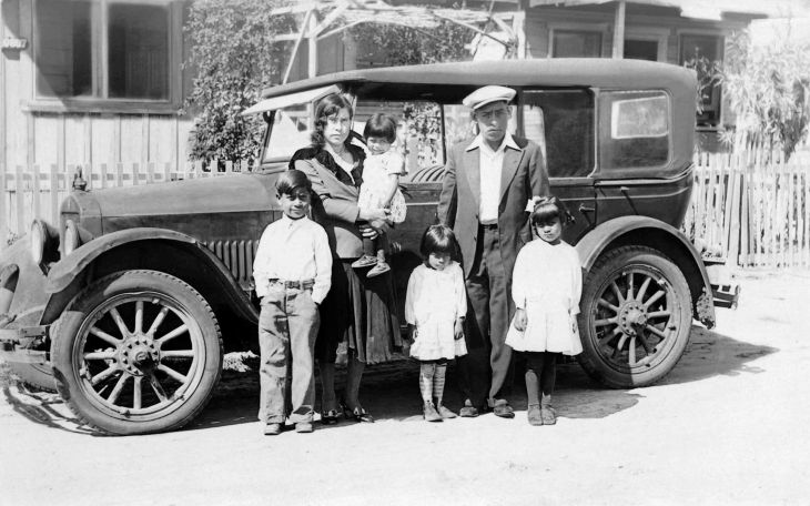 RPPC Of Latino Family With Car In Front Of House 2013.574.1.1