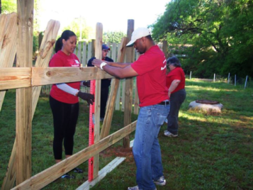 HomeStretch Property Volunteers building fence
