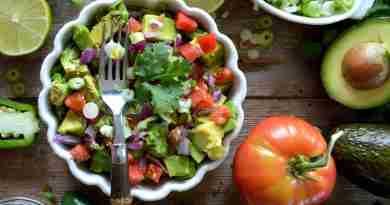 avocados and vegetable salad on bowl