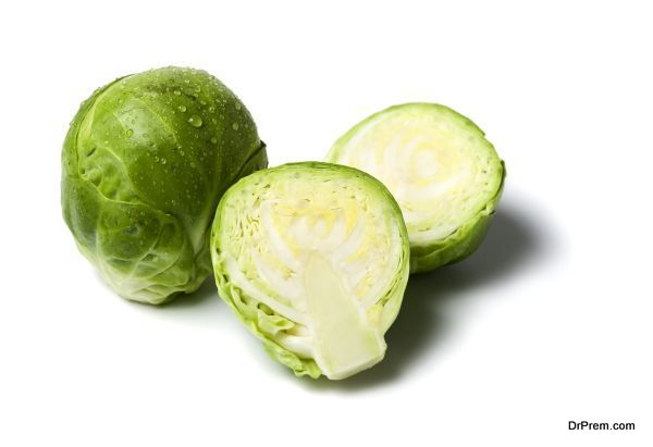 whole and halved brussels sprouts isolated
