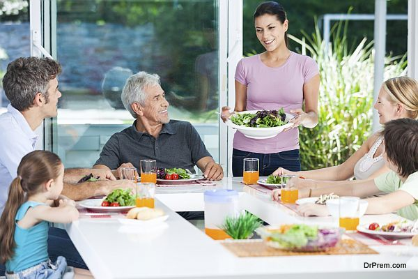 multy-generation family eat at table