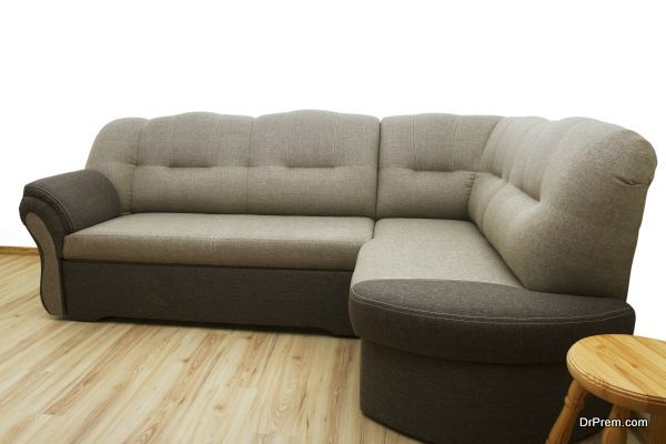 Soft sofa with stool in a flat.
