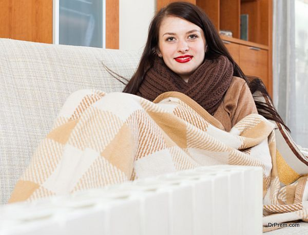 woman warming near electric heater