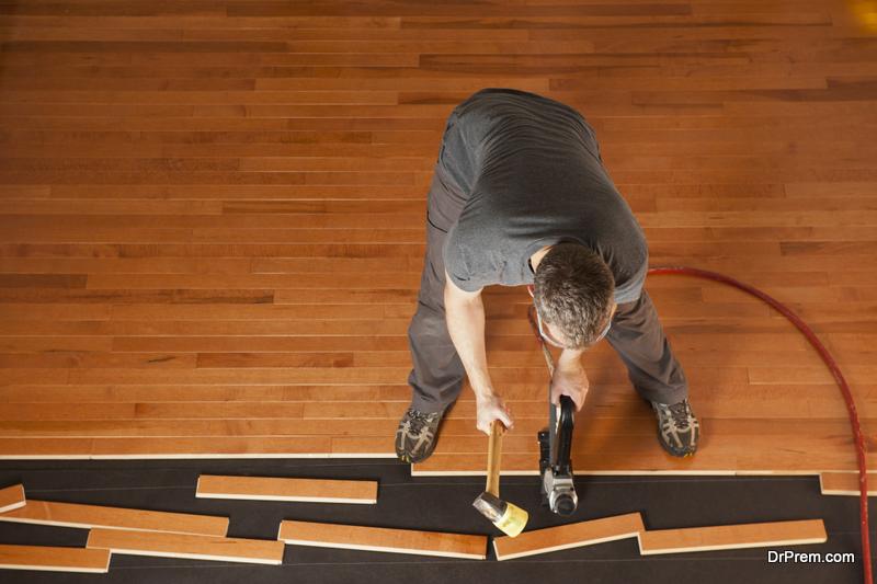 installing planks of hardwood floor