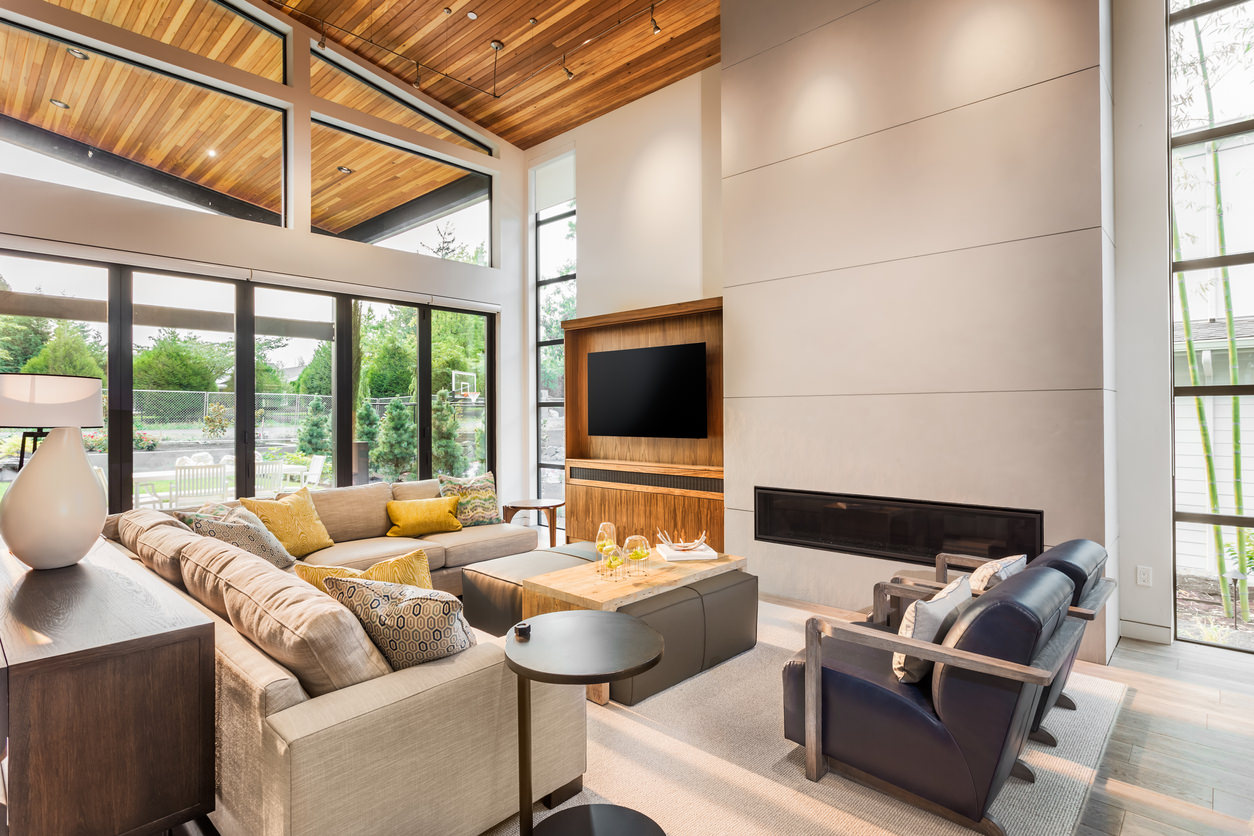 The Modern Organic Family Room is a blend of cool steel-colored walls and warm golden wooden ceiling