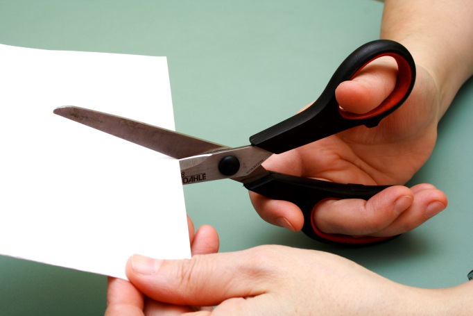 cutting paper with scissors
