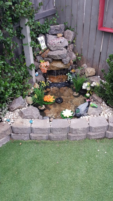 Garden corner rock waterfall ending in pond. The pond was made using  sandpit. Co | Water features in the garden, Fountains backyard, Small water  gardens