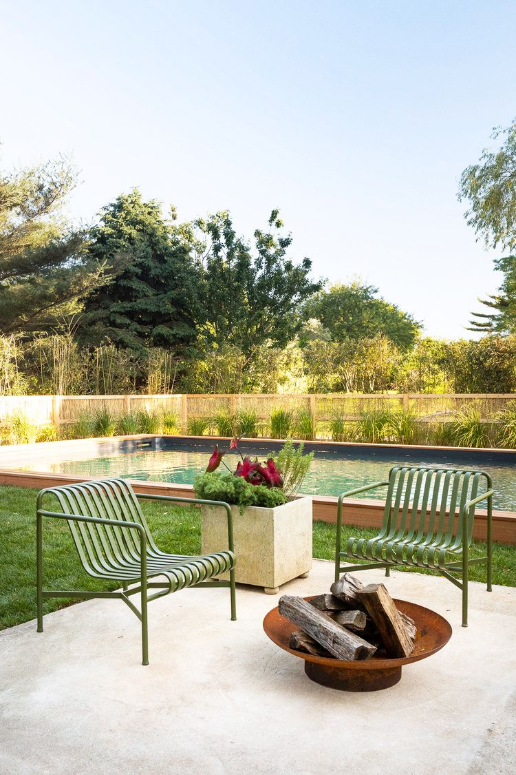outdoor fire pit and pool in backyard