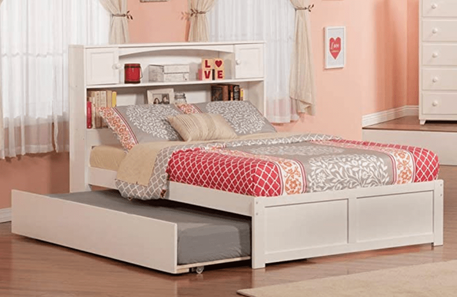 Trundle bed with headboard storage for bedrooms.