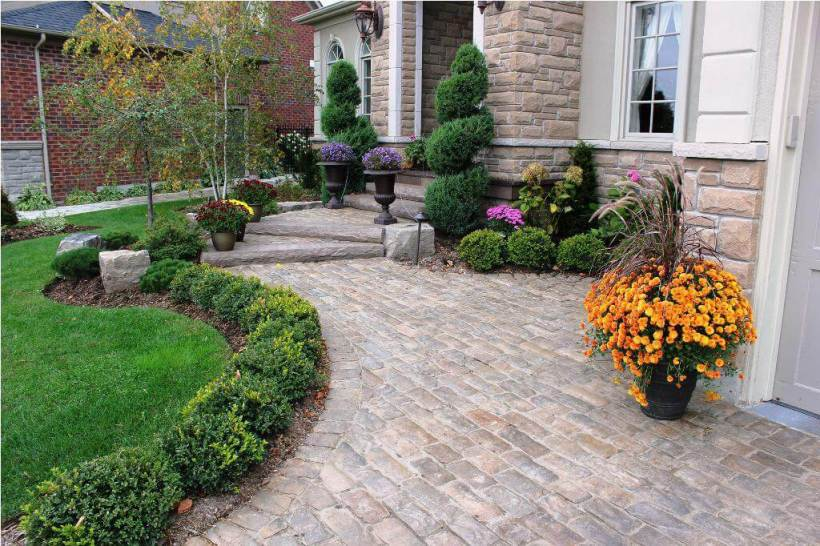 Classic Entryway with Structured Evergreen Beds