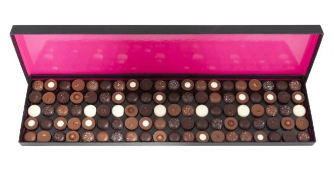 L'Écrin, Fauchon Cette boîte propose un assortiment de 100 chocolats garnis de ganache ou de praliné au chocolat noir, 70 % Venezuela, chocolat lait, 40 % Côte d'Ivoire, et deux nouvelles créations. 140 €. www.fauchon.com