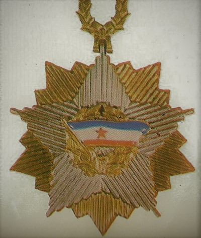 041 the order of the Yugoslav flag with a gold star on a necklace