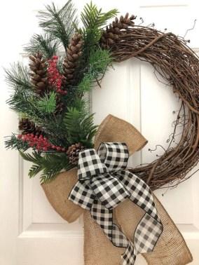 Easy DIY Outdoor Winter Wreath For Your Door 36