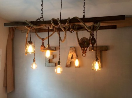 Magnificient Farmhouse Ladder Chandelier Ideas 13
