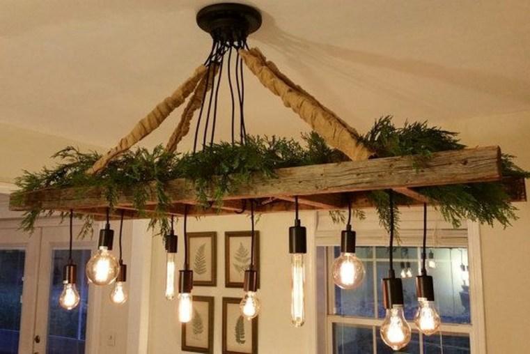 Magnificient Farmhouse Ladder Chandelier Ideas 21
