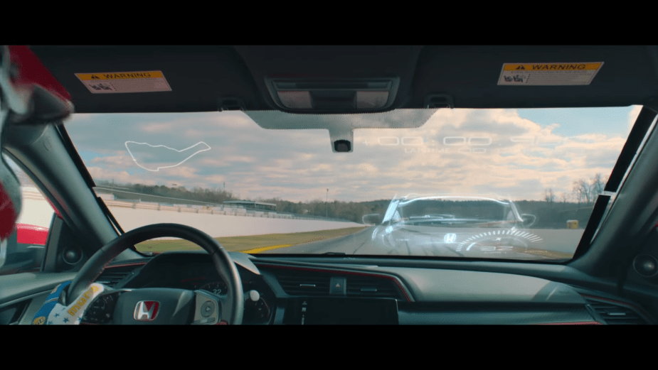 Honda Civic Type R mixed reality race shows a virtual car on the windshield of the real car.
