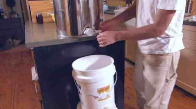 Pouring Honey into an Extractor