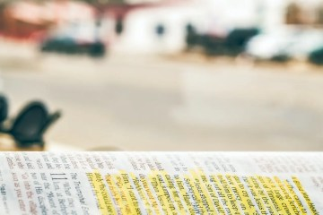 Open Bible with blurred background
